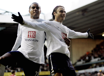 Football - Tottenham Hotspur v Charlton Athletic FA Barclays Premiership - White Hart Lane - 9/12/06 Dimitar Berbatov celebrates with team mate Tom Huddlestone after scoring the first goal for Tottenham Mandatory Credit: Action Images / Alex Morton Livepic NO ONLINE/INTERNET USE WITHOUT A LICENCE FROM THE FOOTBALL DATA CO LTD. FOR LICENCE ENQUIRIES PLEASE TELEPHONE +44 (0) 207 864 9000.
